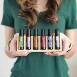 the wholesome nomad - Kelley Wimp - holding essential oils